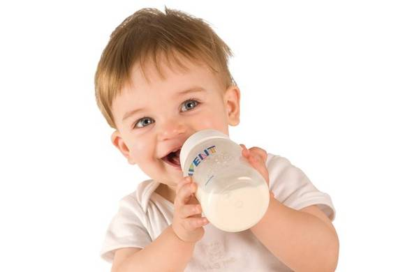 picture showing a little boy drining milk
