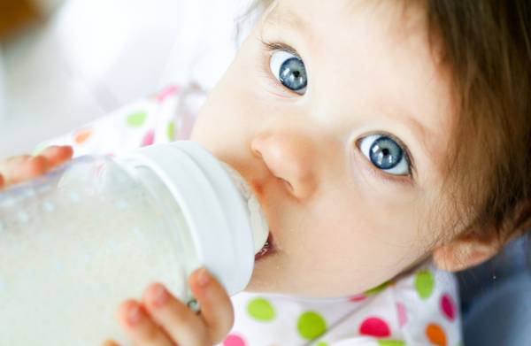 picture showing a baby drinking milk