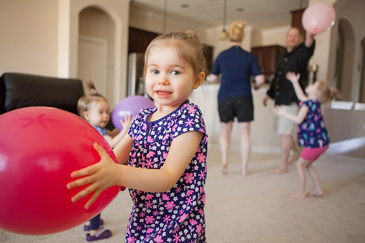 little girl playing with baloon