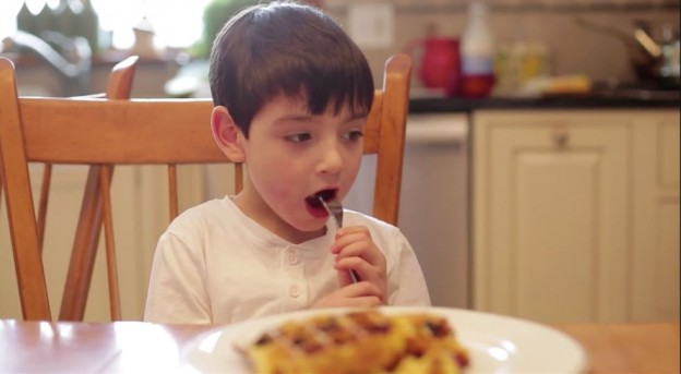 picture showing a boy eating